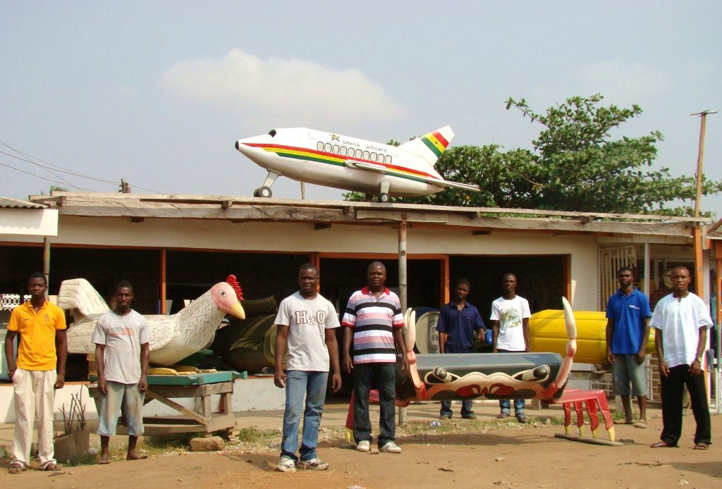 Outside the Kane Kwei workshop in Accra, Ghana where they craft about 300 fantasy coffins a year!