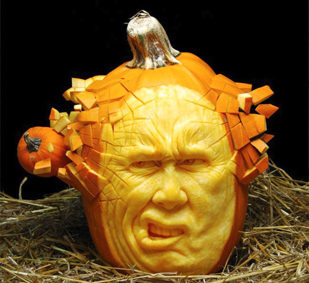the funny face helps too it looks like the guy is only mildly discomforted buy the pumpkin bullet going straight through his skull - Awesome Halloween Pumpkins