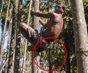 Chandre Oraon climbing a tree