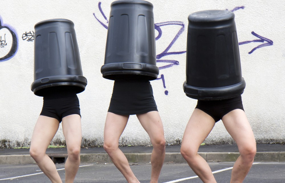 girls in trash cans
