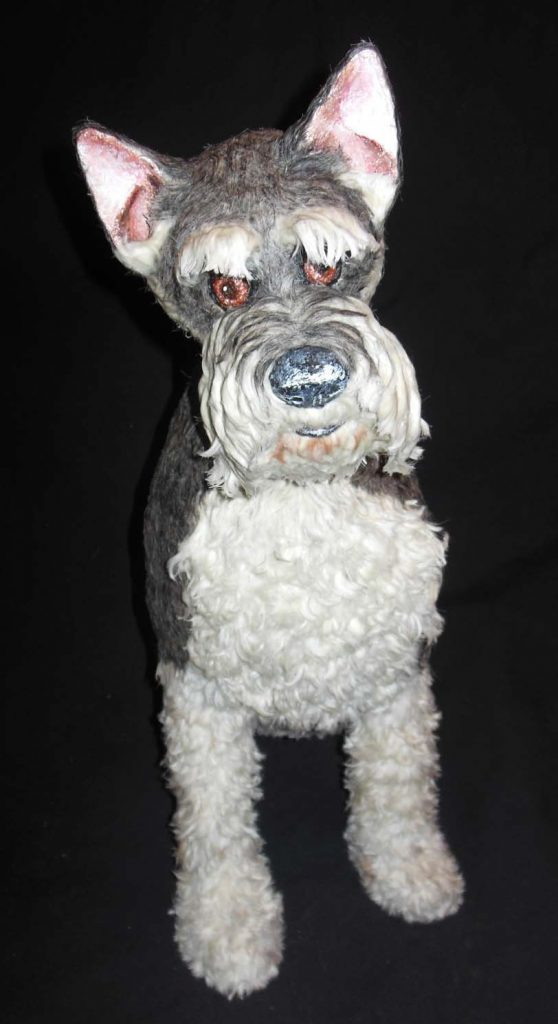 Miniature Schnauzer Sculpture with Real Dog Hair is a 19.5 inches tall sculpture made with paper mache and covered with real dog hair.