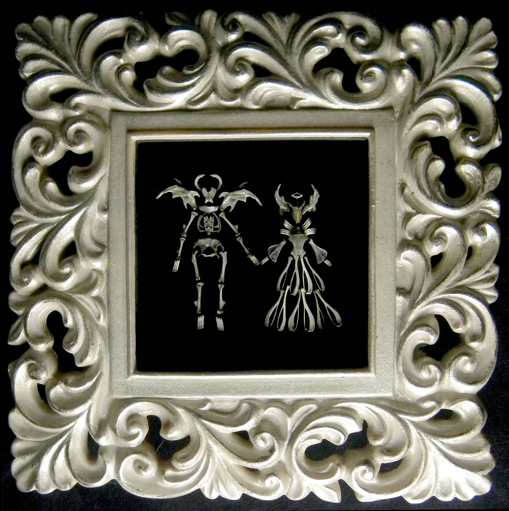 Image of a couple holding hands is made entirely from tiny rodent bones extracted from owl pellets, arranged and glued to a field of black suede.