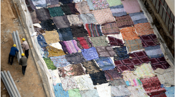 Road in China Covered in Quilts to Prevent From Cracking