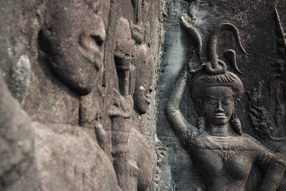 Devatas, carvings on rock walls at Angkor Wat