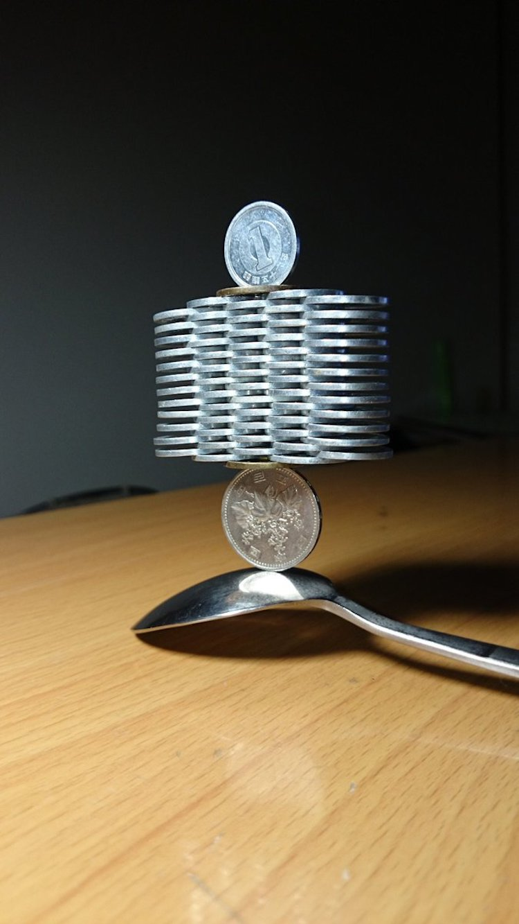 Stacked coins balanced on a spoon
