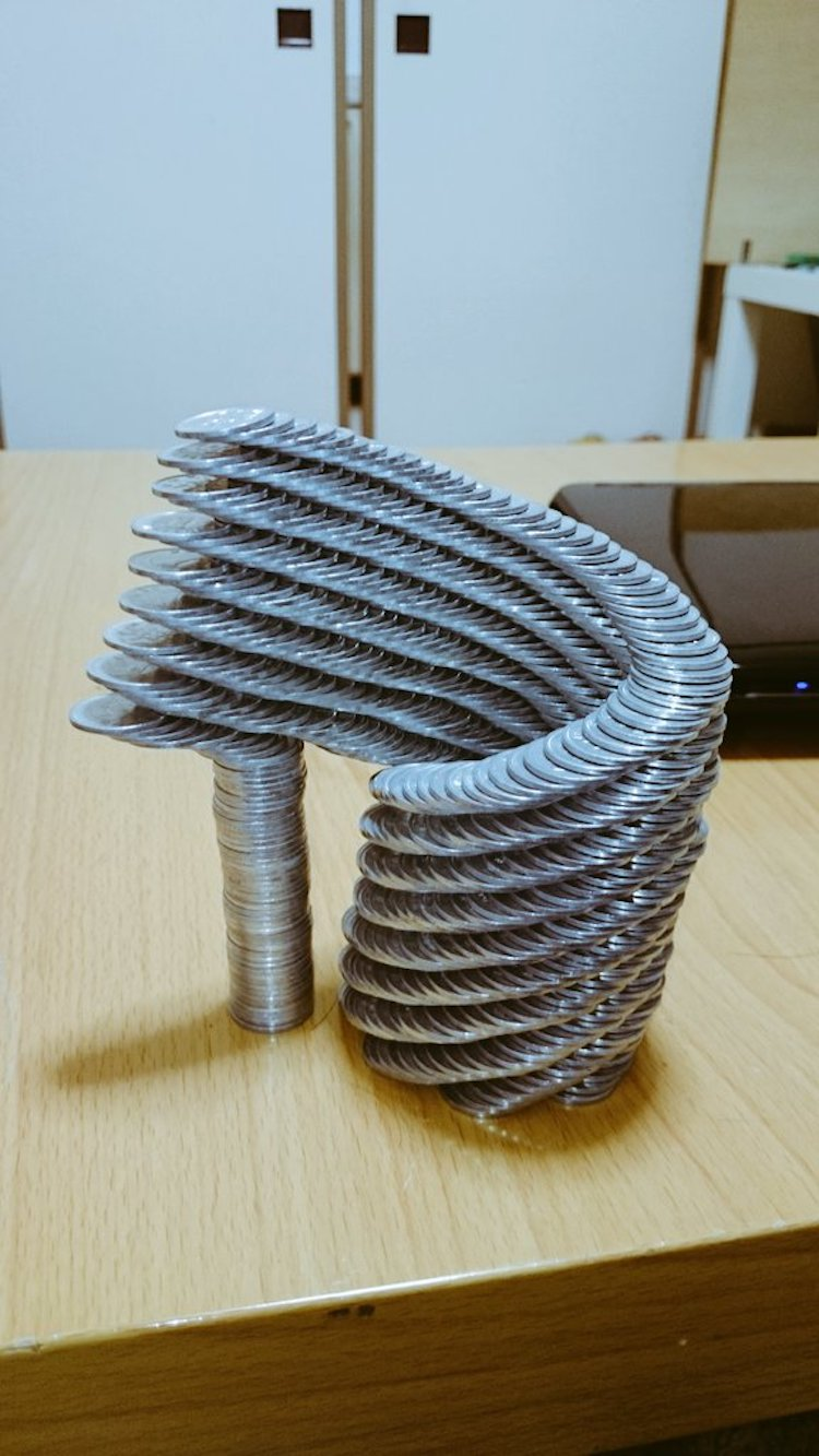 spiral of stacked coins balanced