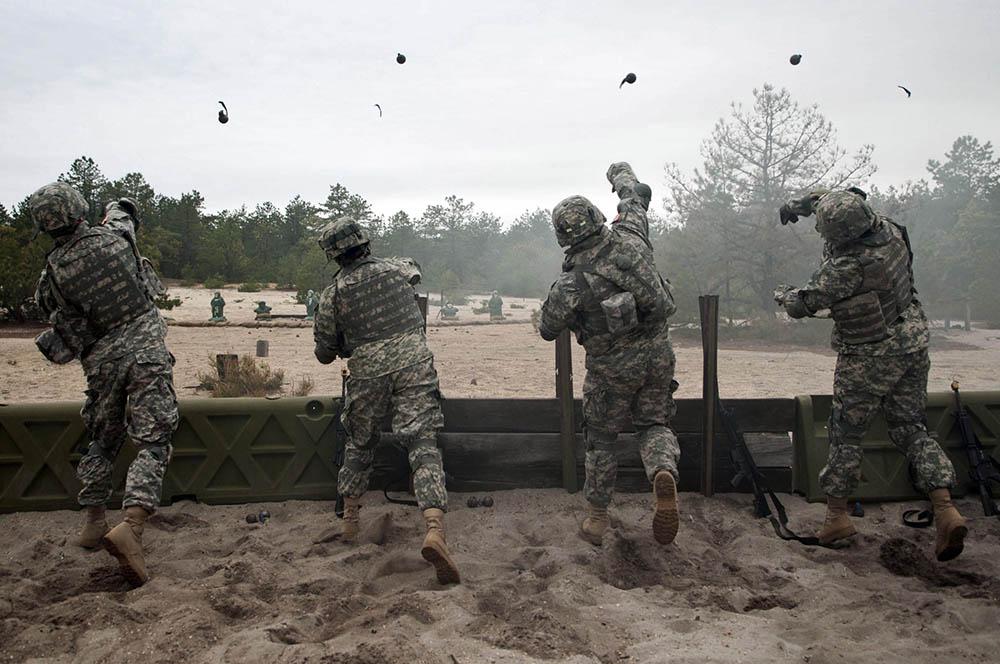 Marines tossing grenades