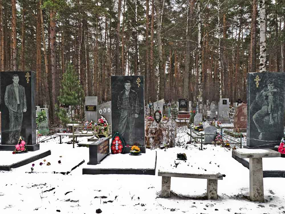 three headstones in russian mobster cemetery