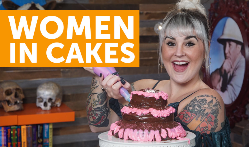 women jumping out of cakes
