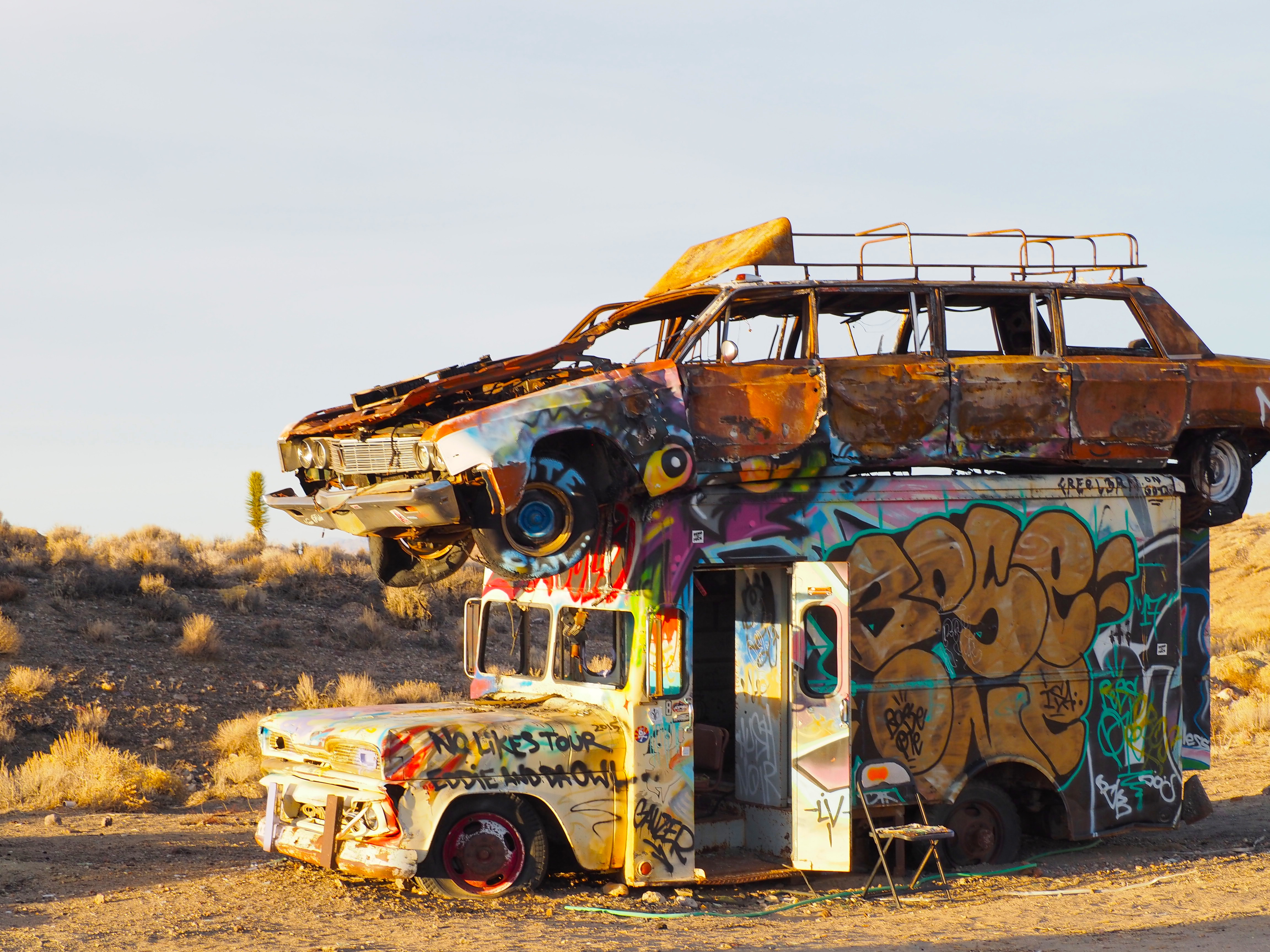 Why are painted cars sprouting out of nevada 39 s desert sands for Mundial decor international nv