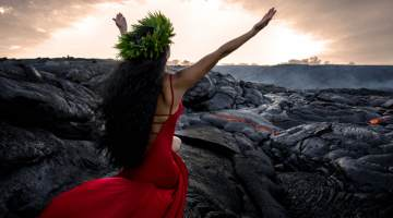 hula dancer in front of lava