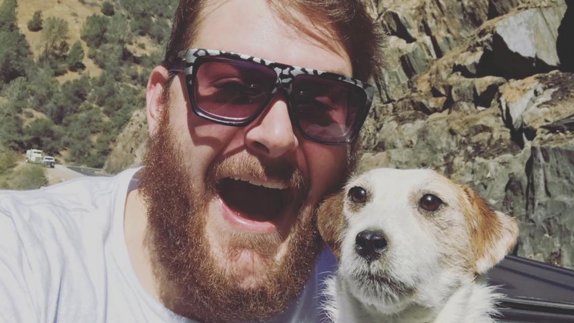 bearded man with dog