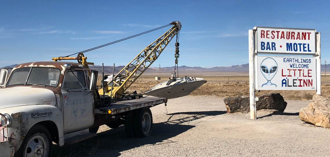 Crane truck moving alien saucer