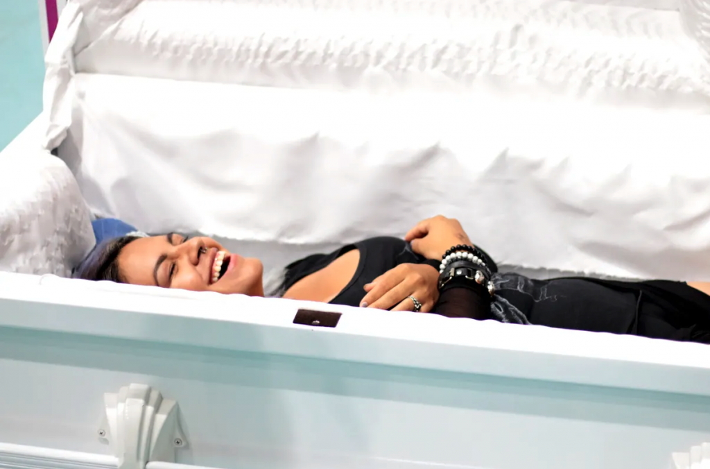 woman laying in casket