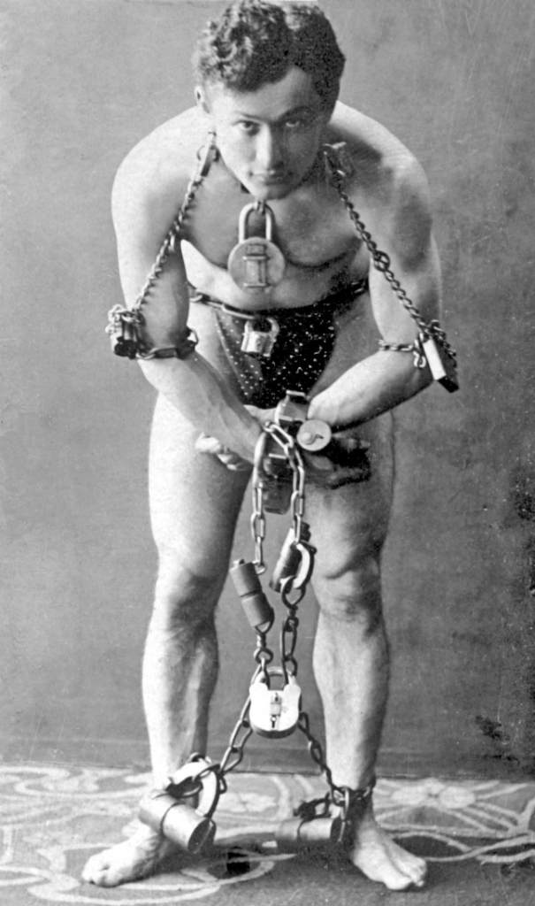 Harry Houdini in locks and chains