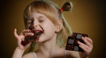Little girl with Chocolate Bar